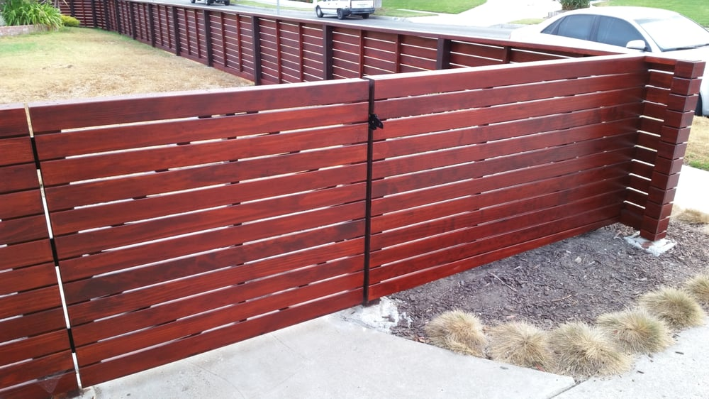 Custom Front Yard Horizontal Wood Fence On Slope Stained