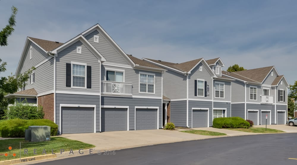 Front Of Apartment Homes All Have Attached Garages With