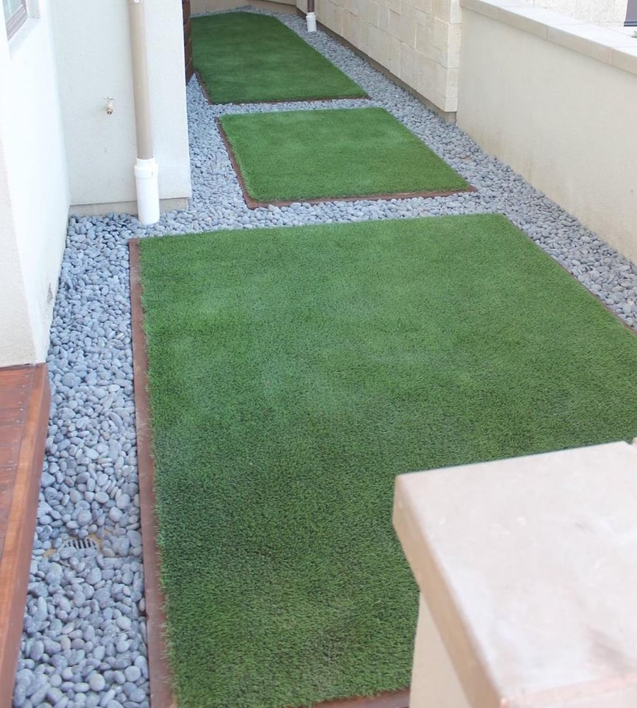 Low maintenance landscaping with artificial turf bordered for Landscaping rocks in los angeles
