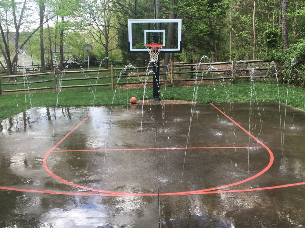 Custom acid stained decorative concrete basketball court for Built in basketball court