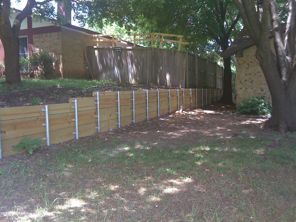 Metal Post Retaining Wall Plank : Wood retaining wall with steel post yelp