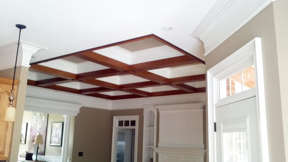 Faux wood beams on a coffered ceiling