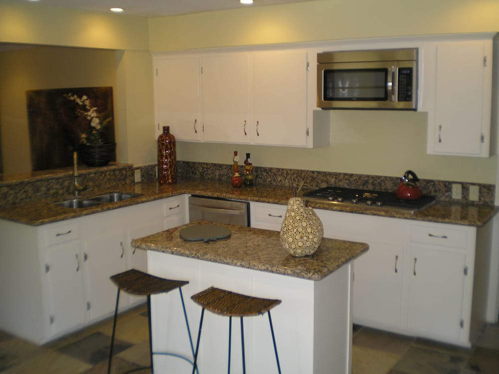Remodeled Kitchen With Granite Countertops Modern Appliances Recessed Lighting Slate Tile And
