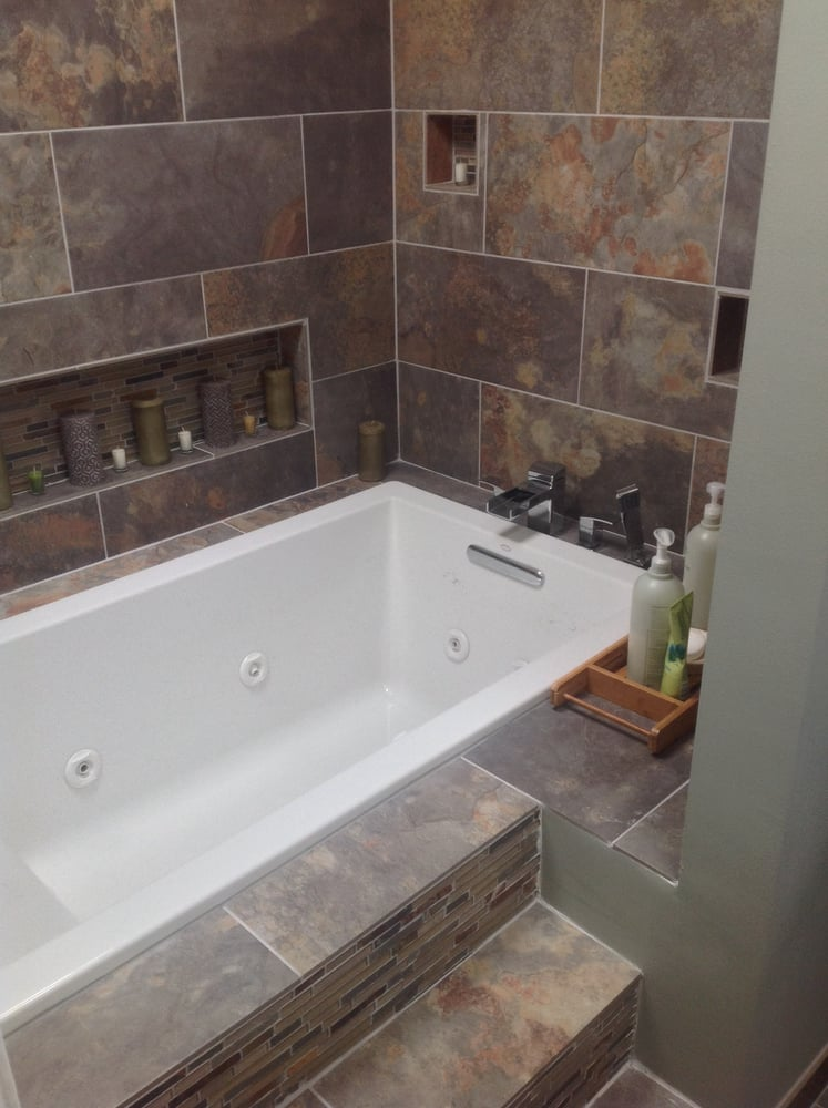 A soaking jet tub install into a tub deck with niche boxes ...