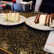 Carrot Cake Cheese Cake Right And Coconut Lemmon Layer Cake Left