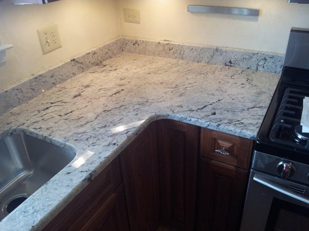 Delicatus white granite countertops by art granite for Granite countertop support requirements