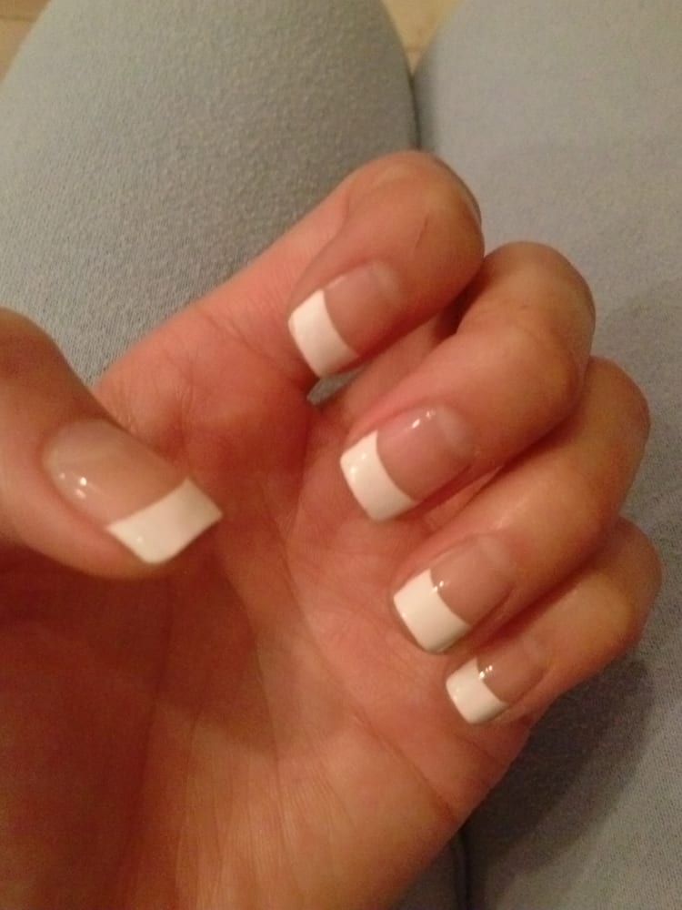 French-tip gel. My nails were super short so I had them draw an ...
