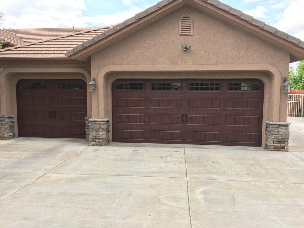 Mammoth garage door 10 foto servizi per porte di for 2 piedi quadrati per garage
