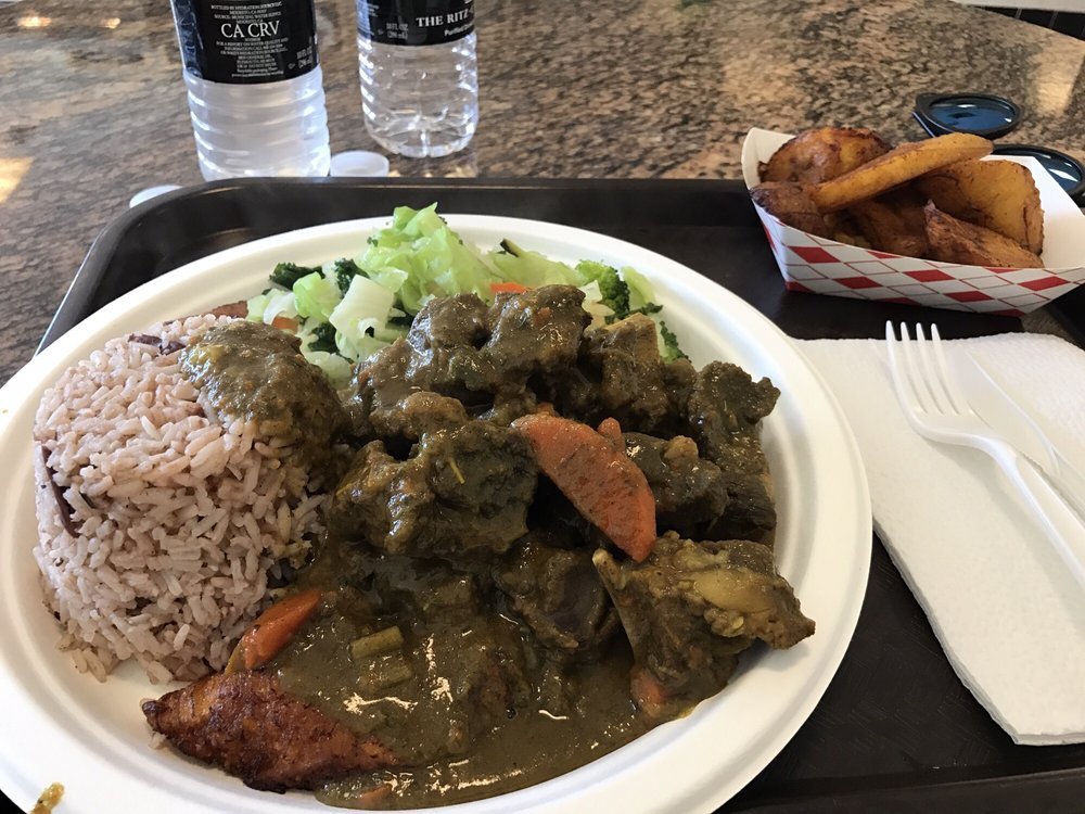 curry goat with rice and beans and side of sweet plantains
