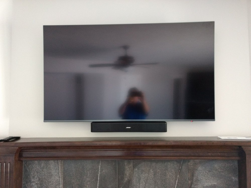 Custom fireplace TV mount with wire concealment - Yelp