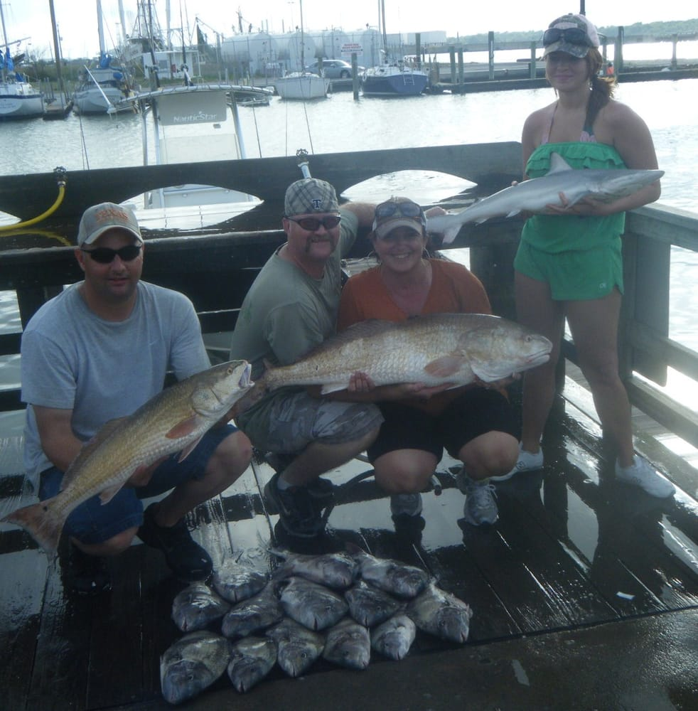Repeat customers with a nice catch of sharks reds and for Get hooked fishing charters
