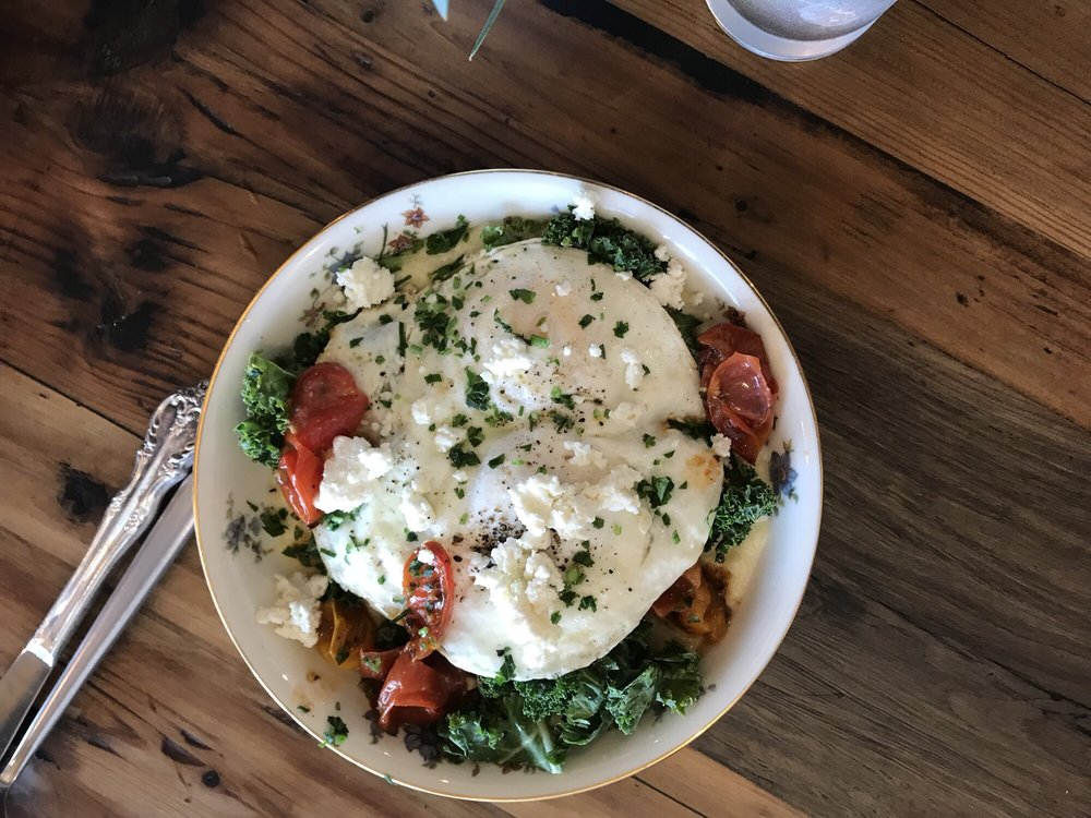 Polenta with roasted tomatoes, eggs, kale, and goat cheese