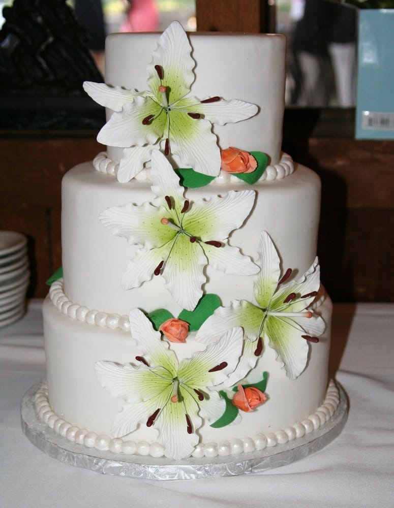 wedding cake decorations pictures three tiered wedding cake with lilies and buds yelp 22407