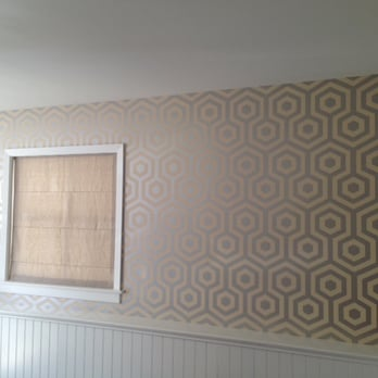 I'm starting a home improvement business--How much is standard to charge for wall papering?