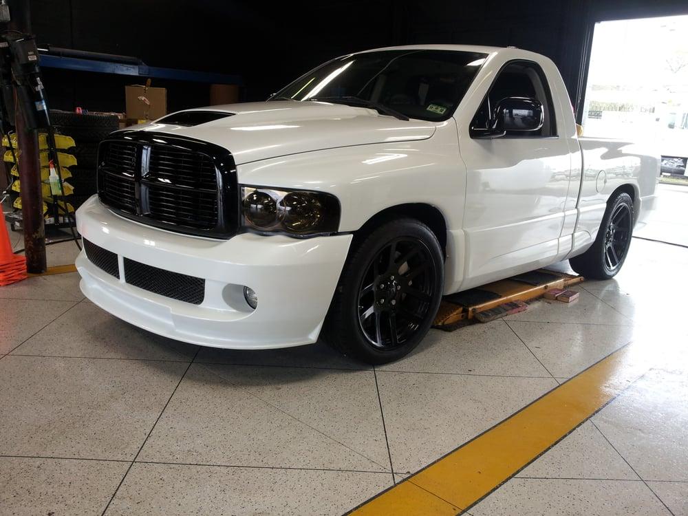 Repaint truck in Custom Pearl White with black grille, scoop