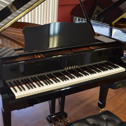 American music world 28 photos piano stores 7136 w for Yamaha piano dealer near me
