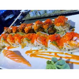 Mizu Hibachi & Sushi - New City, NY, United States. 2 special rolls and one piece of salmon sushi