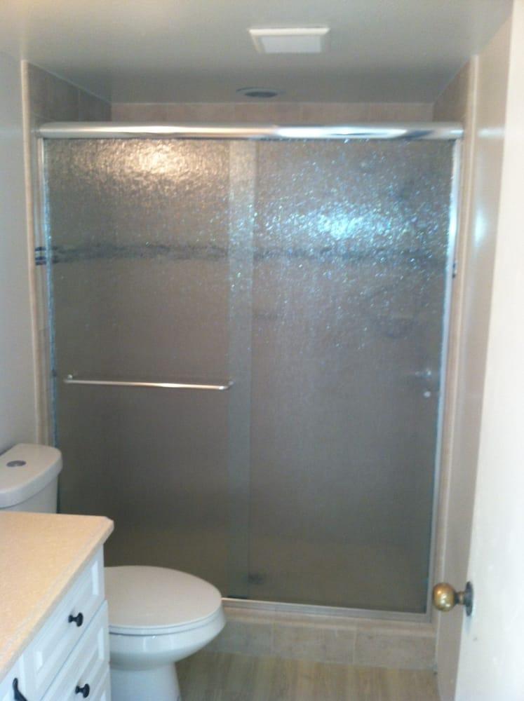 Euro style semi-frameless sliding shower door with rain ...