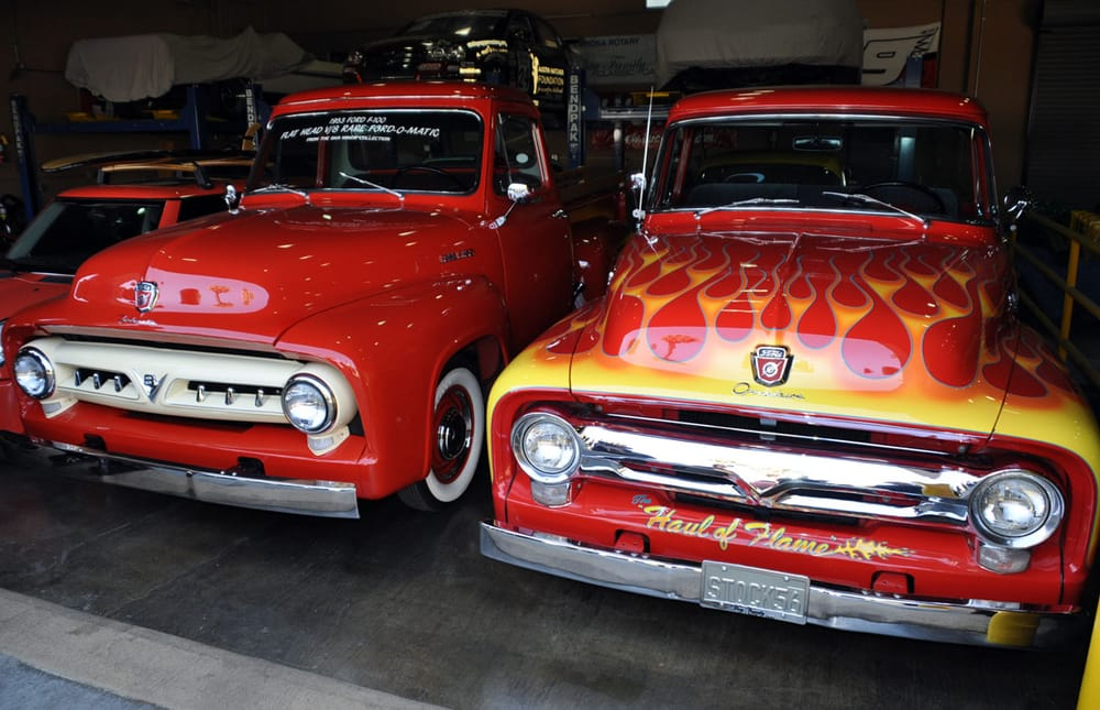 A couple cool old Ford trucks out in the garage too! - Yelp