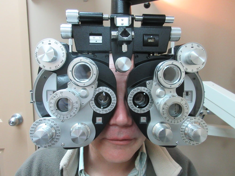 Rob Campbell gets eye exam in Oakville with Dr Ansar Ahmed, Oakville Optician