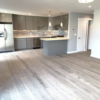 Kitchen and living room with new engineered hardwood floors ...