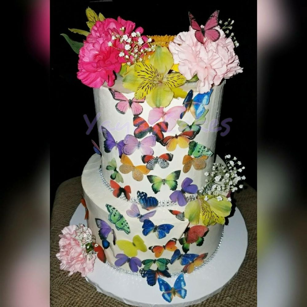 Spring birthday cake, with butterflies and fresh flowers , Yelp
