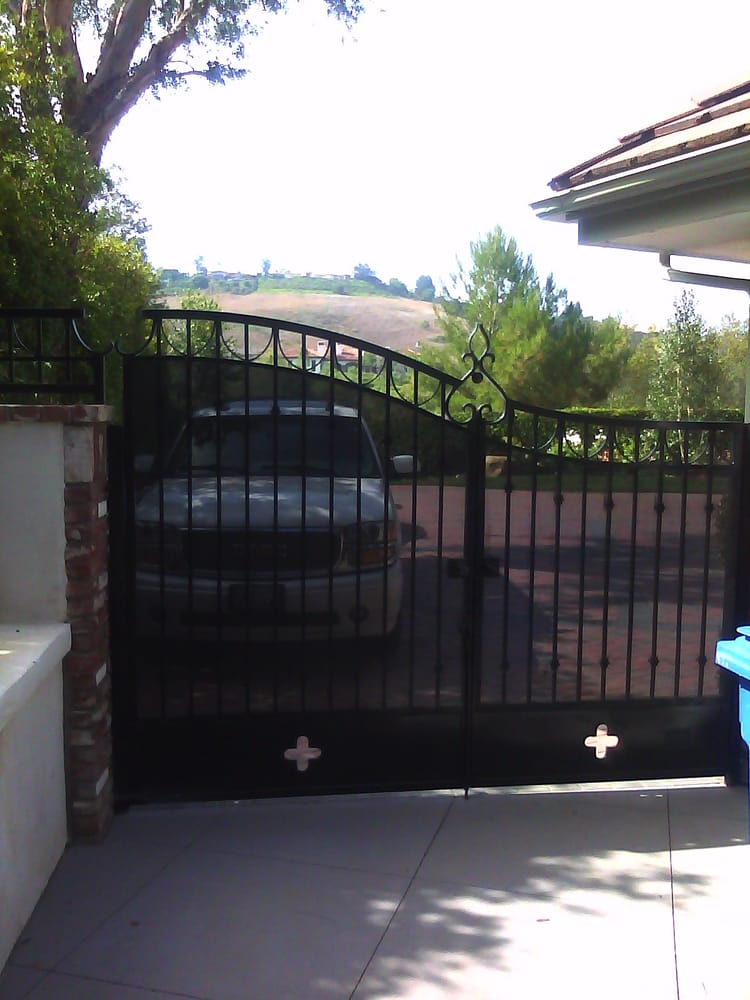 Swing Gate With Perforated Sheet Metal Arch Knuckles And