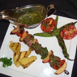 The River Palm Terrace - Edgewater, NJ, United States. Grilled filet mignon kebabs with fresh tomatillo sauce, poblano peppers and grilled polenta.