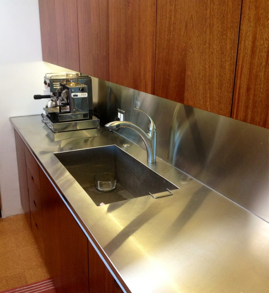 A One Piece Stainless Steel Sink, Countertop, And