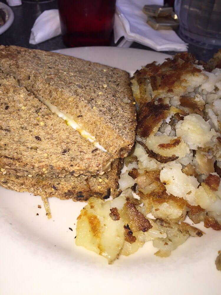 Egg Sandwich On Multigrain With Homefries