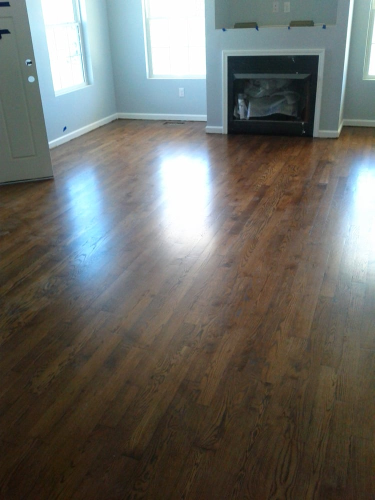 A White Oak Floor Buffed And Coated Stained With Antique Brown