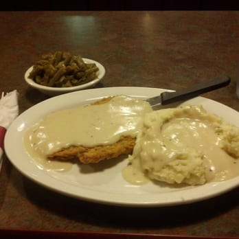 ... Fried steak with mashed potatoes and white gravy, side dish is canned