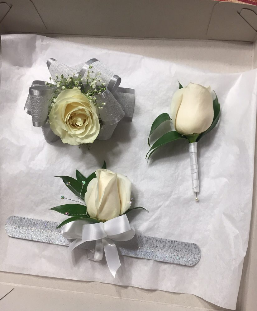 White Garden Rose Boutonniere above left) albertsons $16 white rose corsage (above right