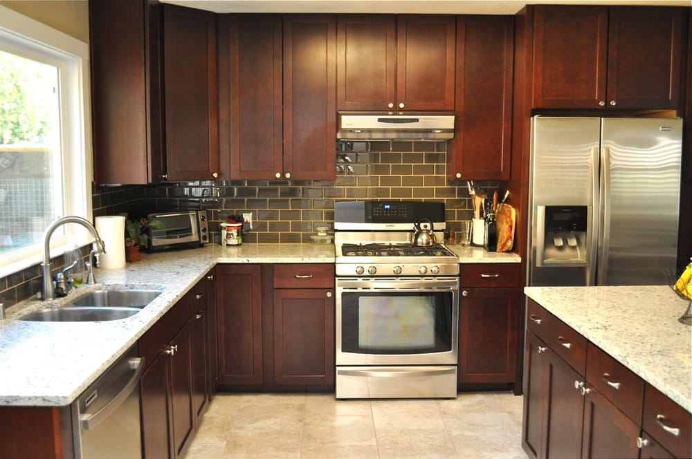 Kitchen Floor And Subway-tile Backsplash. Glass Tile