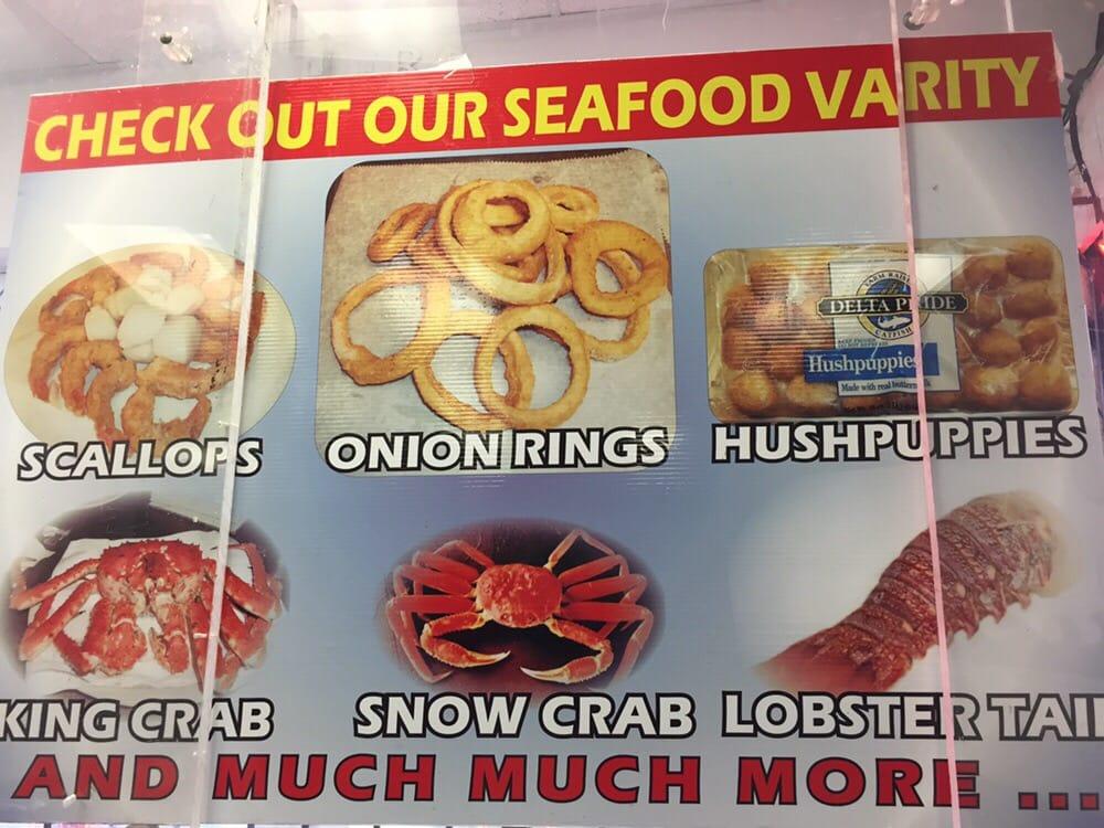 Mr c fish market 38 photos seafood markets 18203 w for Detroit fish market