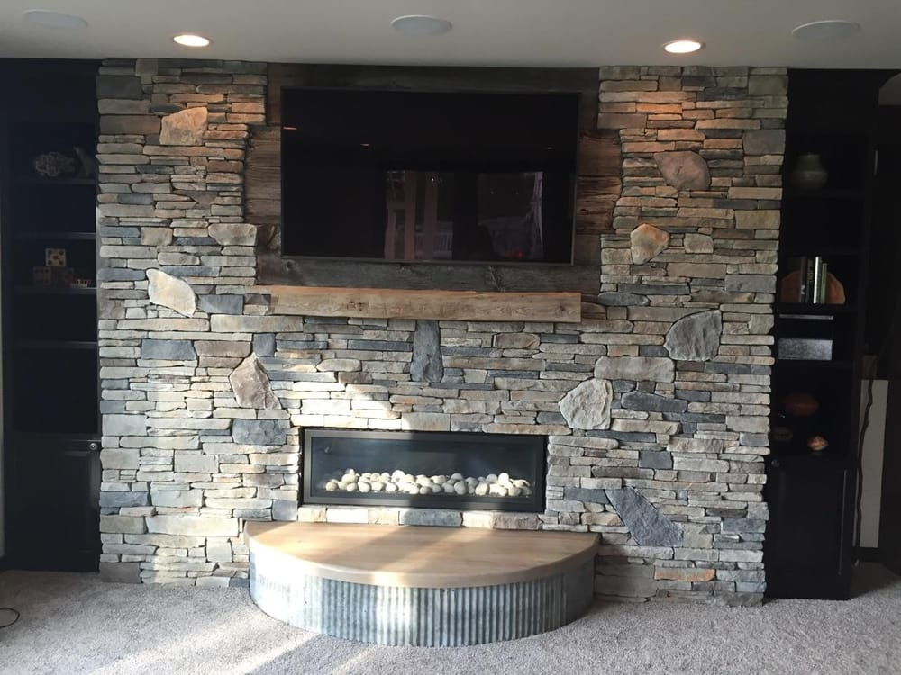 Fireplace done in echo ridge country ledgestone by boral for Country stone fireplace