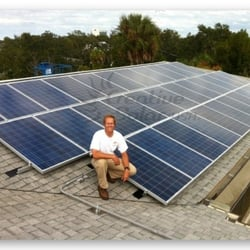 Russell Siefert, Creative Solar next to residential roof installation