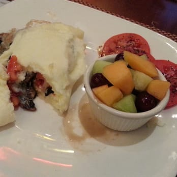 ... Egg white omelette with spinach, tomatoes, mushrooms, and mozzarella
