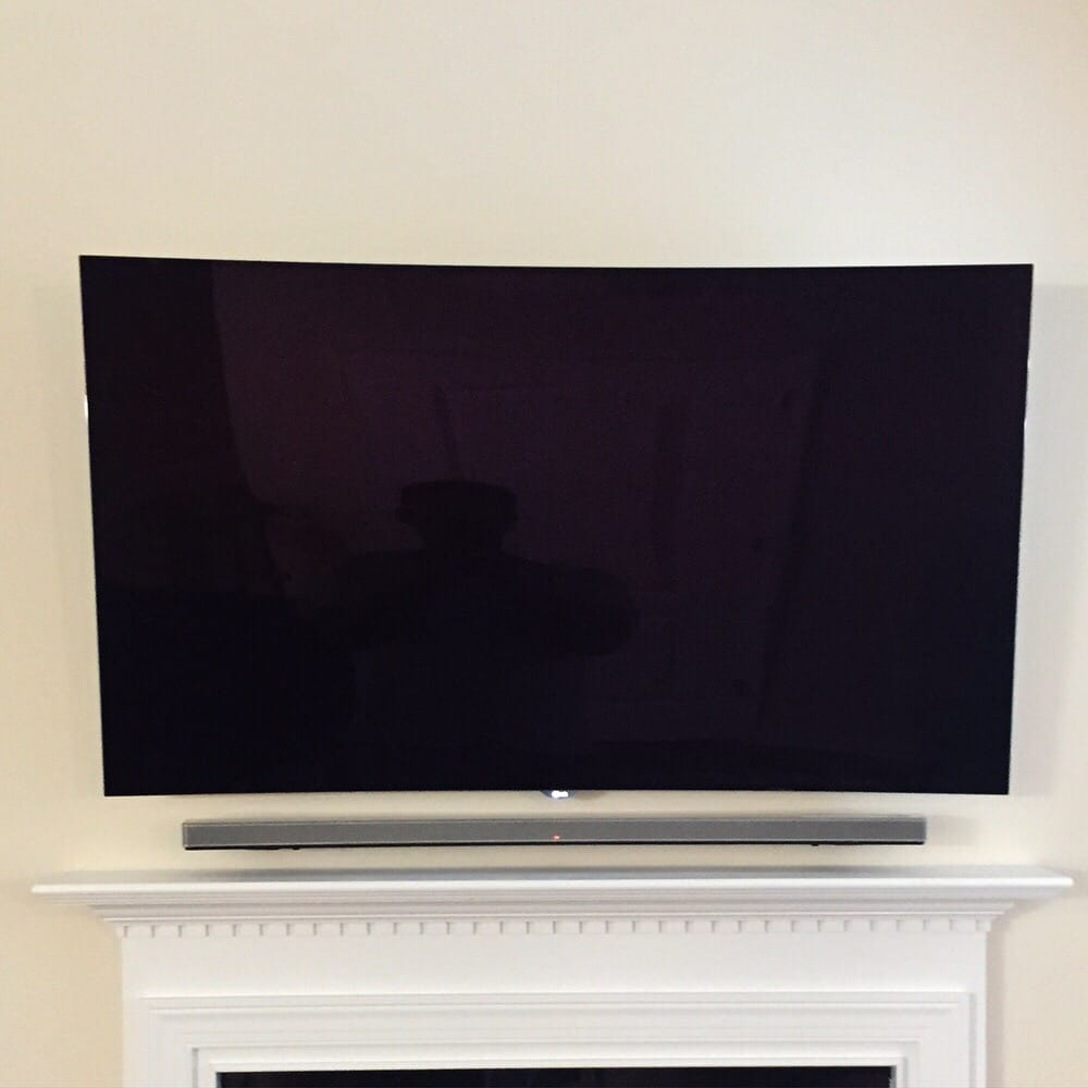 Curved Oled Tv Mounted Over Fireplace Sound Bar Mounted