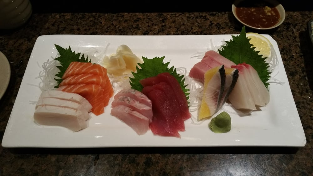 Assorted sashimi with 7 types of fish on the plate yelp for Fish plates near me