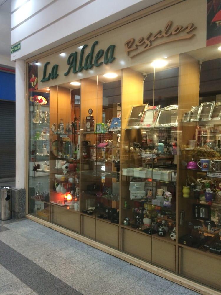 La aldea intimo disco shop l 1045 tienda de regalos for Jardin urbano shop telefono