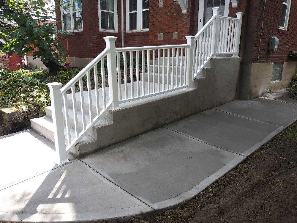 Steps Broom finish Concrete with sidewalk below - Yelp