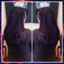 A light silver purple balayage highlights on a dark for A la mode salon brooklyn