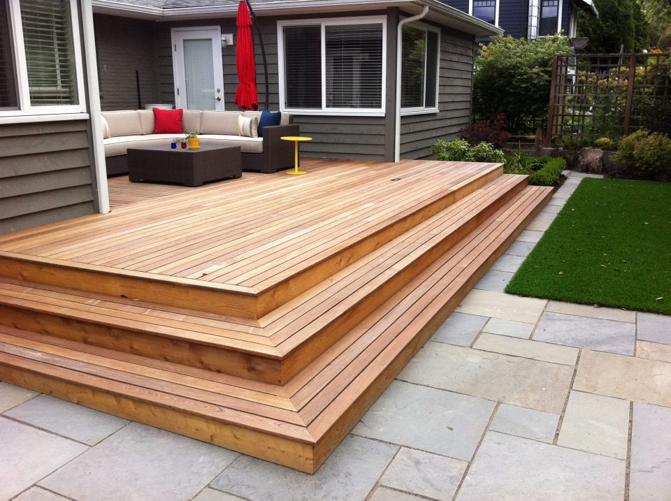 Bronscapes wood decks and stone patios yelp for Outside decking material