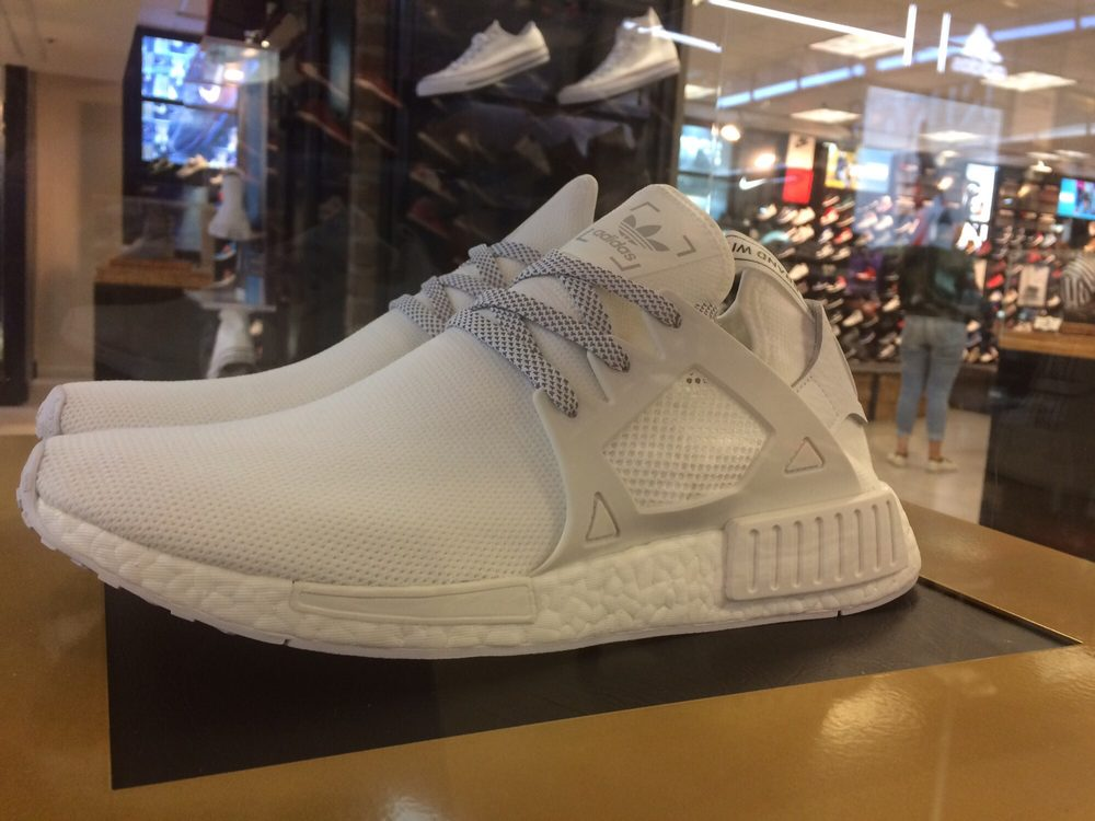 951d9431d615 Encased for a reason.  adidas Triple White Primeknit NMD XR1. Style ...