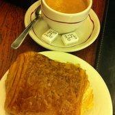 Photo of Pâtisserie Viennoise , Paris, France. Chocolate croissant + coffee/espresso
