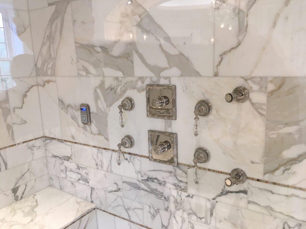 Custom shower completed with (3) body sprayers, rain head, standard ...