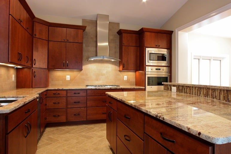 Wondrous Kitchen With A Curved Granite Countertop Island Stainless Home Remodeling Inspirations Gresiscottssportslandcom