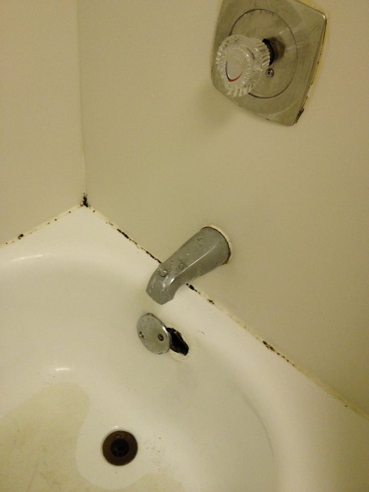 Black mold around edges of tub. Drain cover broken. Missing tub stop ...