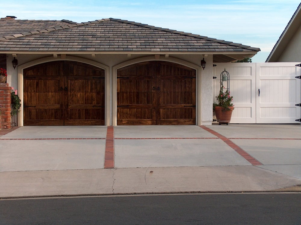 Arched Garage Doors That Look Like Barn Doors That Swing Out In
